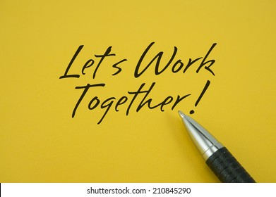 Let's Work Together! note with pen on yellow background