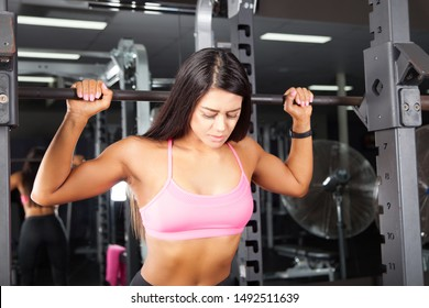 Lets workout woman, in Pink at the gym