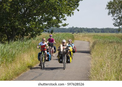 LETTELBERT, NETHERLANDS - JULY 15, 2013: Active family with bicycles and recumbents on a holiday trip in the province Groningen