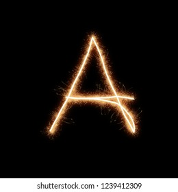 Letter A of alphabet written by squib sparks on a black background.