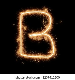 Letter B of alphabet written by squib sparks on a black background.