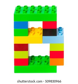 Letter B made from colorful plastic toy bricks isolated on white background