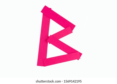 Letter B from parts of red paper.