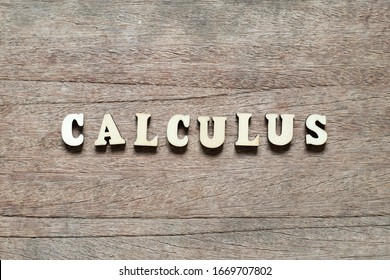 Letter block in word calculus on wood background