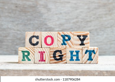 Letter block in word copyright on wood background