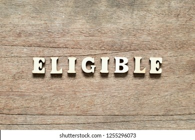 Letter block in word eligible on wood background