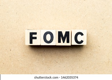 Letter block in word fomc (abbreviation of federal open market committee) on wood background