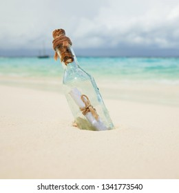 A letter in a bottle on the beach. Island lifestyle. White sand, crystal-blue sea of tropical beach. Ocean beach relax, travel to islands