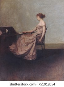 THE LETTER, by Thomas Wilmer Dewing, 1895-1900, American painting, oil on canvas. Portrait of a seated, elegant woman touching a letter on a desk in an austere interior