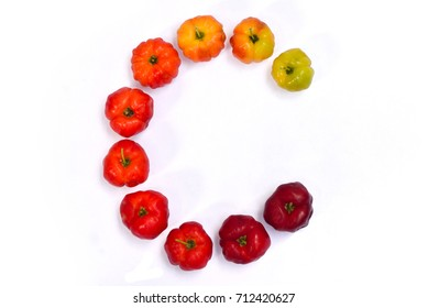 Letter C, font of Acerola cherry fruits on white background