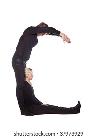 The letter 'C' formed by people dressed in black