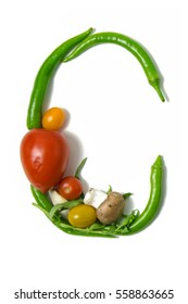 """Letter """"C"""" written with vegetables as a metaphor or concept for healthy lifestyle, vegetarian or vegan diet, getting fit or reducing calories in meals. Isolated on white background."""