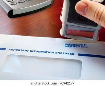 Letter with confidential stamp on the table