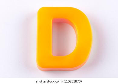 letter D uppercase alphabet isolated made of plastic on white background with shadows