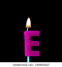 Letter E celebration birthday candle against a black background