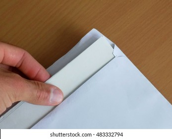 Letter in envelope, man goes to read mail post