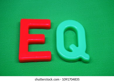 letter eq (emotional quotient) on green background