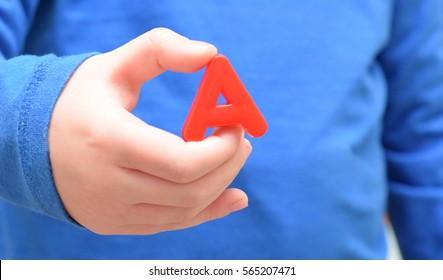 Letter A is in hand of child