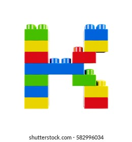Letter K plastic font alphabet character made of toy construction brick blocks. Isolated on white background
