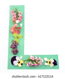 Letter L Made of Spring Flowers and Paper, on White Background.