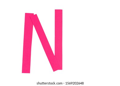 Letter N from parts of red paper.