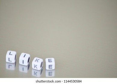 """Letter """"like"""" on dice with creamy background"""