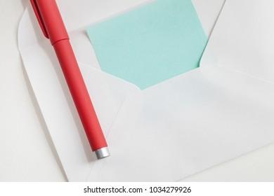 letter paper in envelope and pen