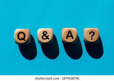 Letter q and a, question mark on wooden ball, turquoise background