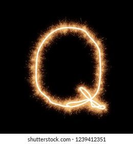 Letter Q of alphabet written by squib sparks on a black background.