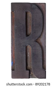 letter R - isolated antique wood letterpress printing  block stained by color inks