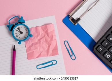 Letter size striped paper sheet crushed note pencil clips portable calculator marker clipboard metal vintage alarm clock wakeup colored background empty text important events