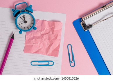 Letter size striped paper sheet crushed note pencil clips marker clipboard metal vintage alarm clock wakeup colored background empty text important events home office school
