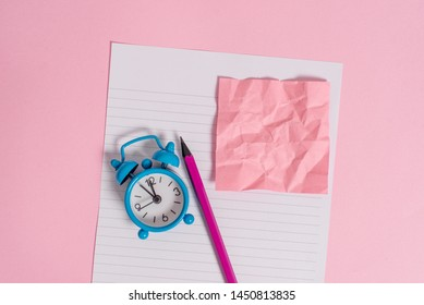 Letter size striped paper sheet crushed note pencil marker metal vintage alarm clock wakeup colored background empty text important events home office school