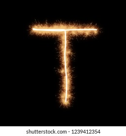 Letter T of alphabet written by squib sparks on a black background.