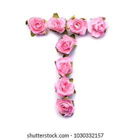 Letter T of English alphabet from small pink roses, isolate on white background