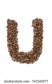 Letter U. Alphabet from coffee beans isolated on white.