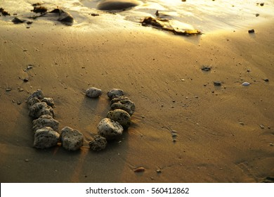 """letter """"U"""" from stone on the beach"""