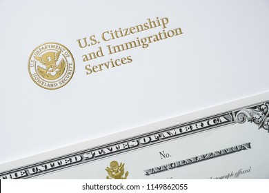 Letter from U.S. Citizenship and Immigration Services with certificate of naturalization/U.S. immigration concept