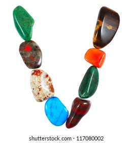 The letter V spelled with semi-precious stones against white background