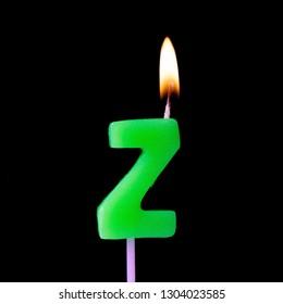 Letter Z celebration birthday candle against a black background