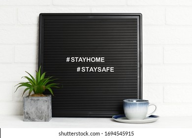 Letterboard with cup of coffee and houseplant