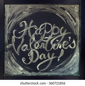 Lettering Happy Valentines Day. Sketch on chalk board. St. Valentine's Day theme. Toned, grunge effect