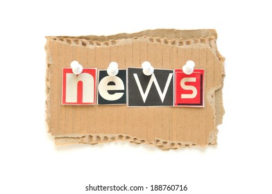 Lettering NEWS with newspaper letters on brown cardboard