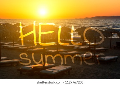 Lettering Say Hello Summer on Fantastic red sea sunset view through black silhouettes of beach umbrellas.