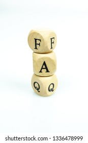 The letters FAQ in wooden cubes on white background