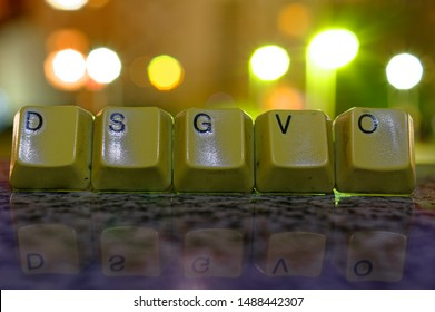 Letters in German DSGVO Datenschutzgrundverordnung and in english General Data Privacy Regulation GDPR with lights in the background