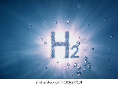letters hydrogen h2 with lot of bubbles in a blue water with sun and rays