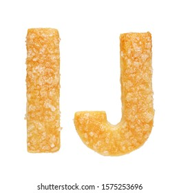 Letters I, J made made from baked dough or cookie isolated on white background