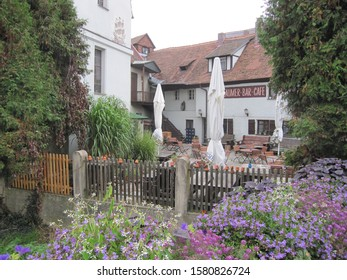 """Letters """"Laumer bar cafe"""" menas in English: """"Cafe and bar of the family Laumer"""", a historical garden tavern in Franconia. - Shutterstock ID 1580826724"""