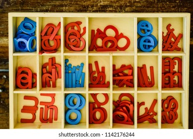 Letters to learn to write and read in your wooden box, montessori classroom.